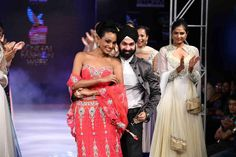 Actress Reshmi Ghosh along with fashion designer AD SIngh at the bengal fashion week. Reshmi Gosh is wearing a coral pink bridal lehenga with corset posing with the couture king and India's leading bridal designer AD Singh. The ramp appeal makes it an amazing pic!