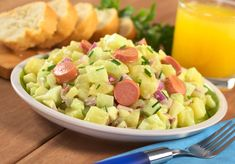 Fresh potato salad made of potato, cucumber, red onion and chives.