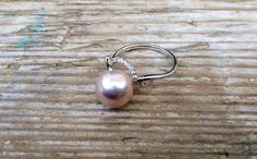 A personal favourite from my Etsy shop https://www.etsy.com/sg-en/listing/241091893/dainty-blush-rose-pearl-ring-size-75