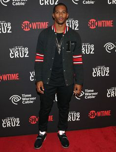 """Victor Cruz Wears Givenchy 17 Bomber Jacket and Nike Trainer Cruz Sneakers at """"I Am Giant"""" New York Screening 