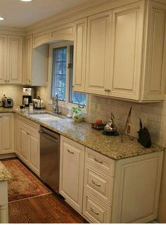 White cabinets, subway tile, beige granite countertops