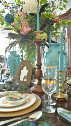 B-e-a-u-t-i-f-u-l tablescape!  Wonderful turquoise appointments, gold, stupendous flower arrangement, I wouldn't even have to eat.