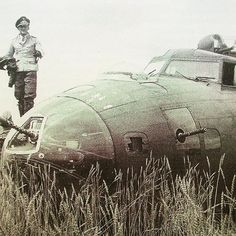 A Luftwaffe Officer admiring  this crashed B-17