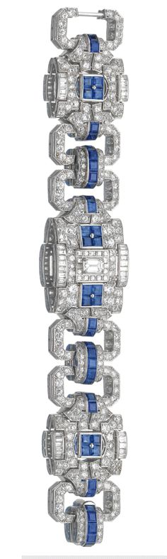SAPPHIRE AND DIAMOND BRACELET    The band designed as a series of geometric links set with calibré cut sapphires, baguette, single- and circular-cut diamonds, length approximately 185mm.