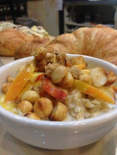 Macadamia Rum Oats topped with sweet nectarines, macadamia crunch brittle, and sweet creamy butter rum drizzle. Delish!  https://www.facebook.com/CoffeeRepublicFolsom