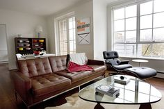Knoll sofa in brown leather, classy. Plus Eames lounger. What a room!