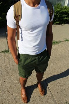 Nail off-duty dressing with this combination of a white crew-neck t-shirt and dark green shorts. Dress up your getup with brown leather loafers.   Shop this look on Lookastic: https://lookastic.com/men/looks/white-crew-neck-t-shirt-dark-green-shorts-brown-loafers/19519   — White Crew-neck T-shirt  — Tan Canvas Backpack  — Dark Green Shorts  — Brown Leather Loafers