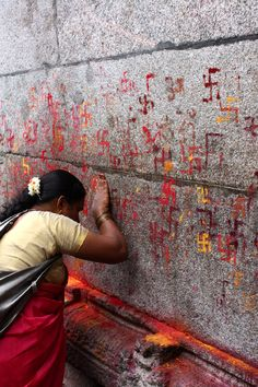 Deep in prayer at the Chamundeshwari Temple, Mysore, India