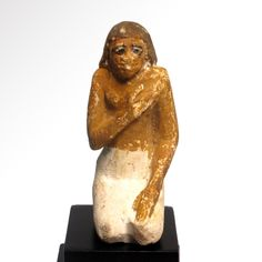 Painted Limestone Figure of a Kneeling Man, Old Kingdom, c. 2400-2200 B.C. Size:7.3 cm H - 2 7/8 inches - Artemission.com