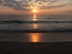 Watch the sun rise over the ocean....hopefully I can do this in August