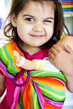 Girasol is/has/will be? making a wrap inspired by this sweet girl's ring sling.  I must have it.
