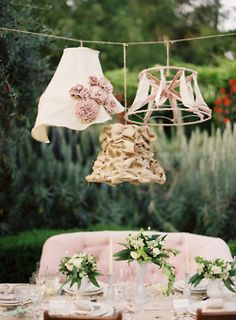Not crazy about the lampshades but LOVE the idea of the wedding couple sitting on a loveseat at the head table!