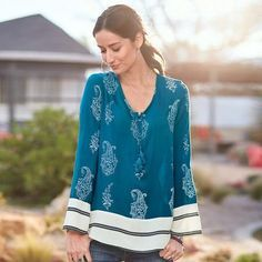 TOPANGA ROAD TUNIC - Our supremely soft rayon tunic contrasts a paisley and flower print with bold stripes around the bell sleeves and border. Braided tassel tie.