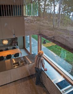 The kitchen inside this house offers views of the nearby fjord