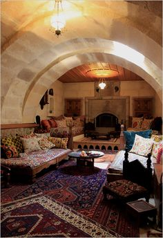 I like this living room. (So would Kurt, as it happens to be built in a cave.) I want to do layered rugs somewhere in my house, but I don't know how.
