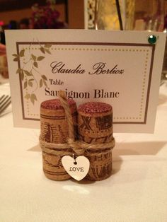 I made these cork place card holders for my nephews wine theme wedding.  I hot glued 3 corks together.  Bought the heart charms at Michaels, and tied it together with twine.  The place cards I designed and printed on a nice paper stock.