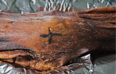 A cross-shaped tattoo on Ötzi's knee.  Researchers have found 61 different tattoos on his body so far.