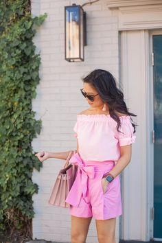 COLOR & CHIC | Pink off the shoulder top and pink bow tie shorts with Saint Laurent Sac de Jour