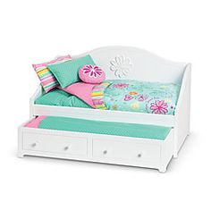 My 4 year old girl loves American doll. She is just 4 but plays and take care her dolls in a nice way! This is her first pic in Santa's list. Have a great review and sleeps 2 dolls.  American Girl® Furniture: Dreamy Daybed & Bedding