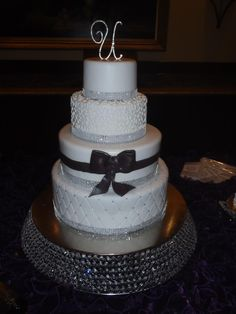 Glitz, glamour and sheer elegance topped off with a black fondant bow make this wedding cake perfect for the ultimate #LuxBride. Wedding theme ideas: Black and white, metallics, silver, rhinestones, sparkle, Hollywood. #Weddingwednesday