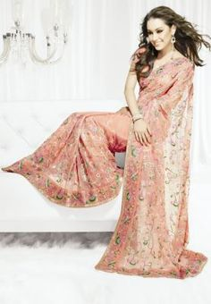 Celebrate womanhood this season with this pink saree from the Neeta Lulla collection. Intricately designed with sequins, resham and zari work, this saree is crafted on mono-coloured net. Wear it with the matching blouse or pair your silver/golden backless choli with it to add the needed uniqueness and oomph.