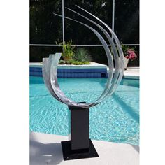 Title: Triple C  Dimensions: 40 x 33 x 9, including the 12 base (101.6 cm x 83.82 cm x 22.86 cm, including the 30.48 base height)  Color: All Natural Silver with Black Base  This sculpture arrives completely assembled and ready to enjoy. A Certificate of Authenticity, rubber bumpers for interior display, and helpful artwork display tips are included in every package. All artwork is quality inspected and gallery wrapped to ensure safe global transit.  This unique eye-catching, breath-taking…