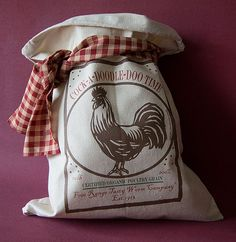 """The feel of the Vintage Flour Sacks with original designs. Size 16""""x13"""" (10 lb) w/cotton drawstring. (Stuffing & ribbon not included).    One of a kind storage for rice, coffee beans, pine cones, our Extra Heavy Flour Sacks can be used as Unique Primitive Decor for every Americana Household.    You can turn them into Country Pillows! Sew them into Runners! Purses, Bags, Seat Cushions, Christmas Tree Skirt! Quilts!"""