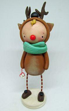 Christmas kid wearing a Reindeer costume with peppermint sticks Reindeer Costume, Reindeer Face, Peppermint Sticks, Christmas Holidays, Christmas Ornaments, Clay Art, Kids Wear, Handmade Art, Folk Art