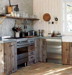 Bare wood kitchen cabinets.