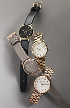 Marc Jacobs watches.  I'll probably buy the black/gold next week.