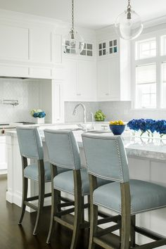 Two Clear Glass Globe Light Pendants Illuminate A White Kitchen Island  Topped With White American Quartzite Fitted With A Prep Sink And Gooseneck  Faucet ...