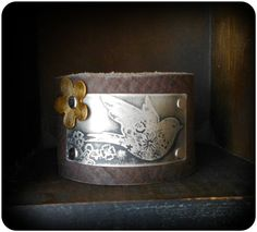 Hey, I found this really awesome Etsy listing at https://www.etsy.com/listing/166863719/etched-sparrow-leather-cuff-bracelet