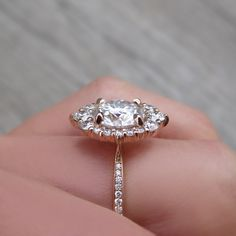 A vintage-inspired halo ring with a colorless Forever One Hearts & Arrows or Supernova moissanite. Conflict-free lab-grown or Canadian mined diamond halo encircles the round moissanite. Perfect Engagement Ring, Diamond Engagement Rings, Halo Engagement, Coffin Nails, Heart With Arrow, Unique Rings, Halo Diamond, Pink, Halo 2