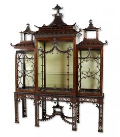 28: A CHIPPENDALE STYLE CABINET-ON-STAND England, Late : Lot 28