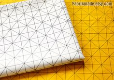 This fabric is a cotton fabric with geometry pattern. 2 colors: yellow, white.  * Cotton fabric: 100% cotton, diamond plaid pattern, a bit light weight. 160g/yard * Width 63 inch (160cm), listed for 18X63 (45cm x 160cm). If you need one yard, I will ship 90 cmX160cm. * Additional yardage will be cut in one continuous piece. * Suit for sewing crafting, home decor, quilt, lining, sewing crafting decor, clothing, bag.   I can combine shipping on multiple purchases, combined shipping costs a...