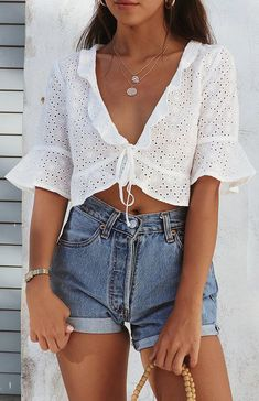 7558c26193a494 cute summer outfit ideas for teens high waisted vintage denim shorts white crop  top www.