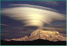 7. Lenticular Clouds   Lenticular Clouds, technically known as altocumulus standing lenticularis, are stationary lens-shaped clouds that form at high altitudes, normally aligned at right-angles to the wind direction.    These clouds can often be mistaken for UFOs!