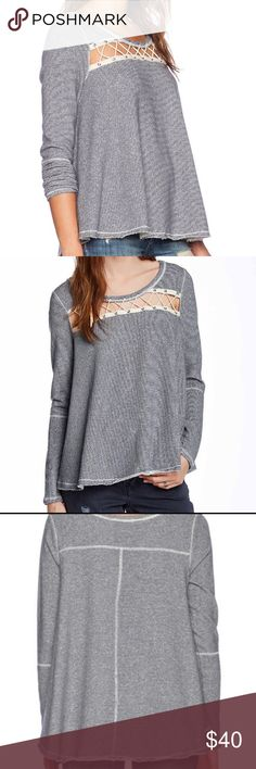 NWOT Free People Lacey Love Sweater Free People Lacey Love sweater is soft and swingy, indigo and cream striped fabric, raw edges, cool twine and grommet detail in front, super soft loop terry inside to keep you cozy. It's called a sweater, but it's more of a sweatshirt weight. Fabric content/care in last pic. Size small, but oversized fit could accommodate a medium as well.  No trades please, reasonable offers considered ❤💕❣️ Free People Sweaters Crew & Scoop Necks