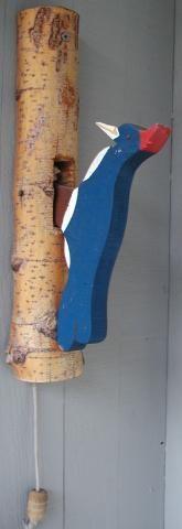 DIY woodpecker door knocker plans.