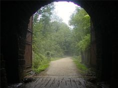 Pic of the Day... the fascinating railroad history of what is now the heralded Elroy-Sparta State Trail in Wisc. is as much an attraction as the scenic route itself. Built in the late 1800s, these tunnels include massive wooden doors at each end, which during winter were closed between trains to prevent snow accumulating inside. Learn more rail-trail history at: http://www.traillink.com/