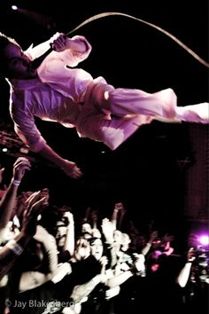 Mike Patton side-flying.