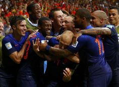 Arjen Robben of the Netherlands is hugged by his teammates after scoring a goal against Spain. The Netherlands defeated Spain 5-1.