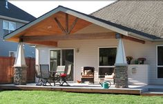 porch covers ideas   Patio cover with stone pillars