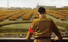 One of the most intriguing images of Hitler as he overlooks a rally in Nuremberg.