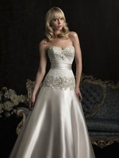 Allure Bridals: Style: 8954  I wish the ribbon around it tied at the back, but no, it doesn't, and it has buttons on the back, which I hate.