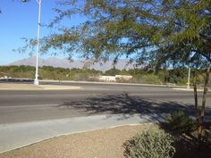 Looking across Miracle Mile toward the cemetery--the route that Anna and Foster must follow. That's the mortuary in the distance. Nick follows from a slightly different angle, but faces the same obstacles. Different Angles, Cemetery, The Fosters, Distance, Arizona, Sidewalk, Anna, Country Roads, Faces
