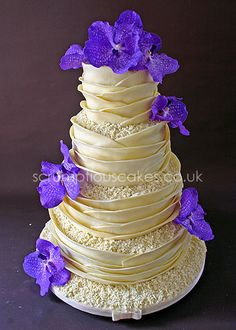 www.scrumptiouscakes.co.uk (535) - 4 tier white chocolate wrap wedding cake with fresh purple orchids.