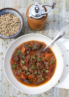 [ Recipe: Beef and Lentil Stew ] made with oil, beef chuck, onion, garlic cloves, carrots, celery stalks, dried lentils (green or brown), crushed tomatoes, beef stock, red wine (dry), bay leaves, dried thyme, cayenne pepper, chopped tarragon, salt and pepper. ~ from A Spicy Perspective.