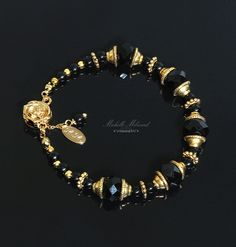 Black+&+Gold+Abacus+Faceted+Beaded+Bracelet+by+MichelleMilward,+$32.50