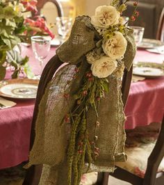 Great way to spruce up a holiday table with a burlap chair bow! This would be a way cute idea for a country or western themed wedding